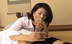 Mature asian milf jerking a cock