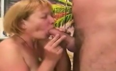 Filthy Blonde Grandma Kneels To Suck A Younger Dick