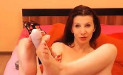 Sexy redhead MILF gives her dildo a footjob
