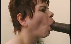 Amateur brunette with short hair takes on a big black cock to fuck