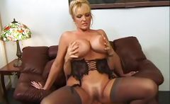 Mature blonde with big hooters gets some deep drilling from a gent