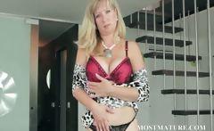 Mature blonde hottie stripping sensually